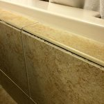 Missing caulking/grout around the tub