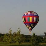 Chasing the balloon as it hovers close to the ground