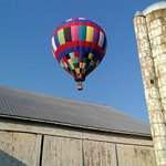 The balloon flying over farms and barns - quite a sight!
