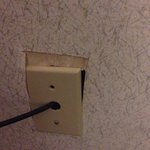 Cable plug plate over falling off, and stuck behind the wallpaper that was apparently applied wi