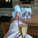 Enjoying champagne and the fireplace in Dream Cabin #9