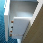 Drawer in room - not the only one where the front falls off