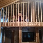the kids loving their loft while mommy and daddy unpack
