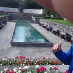 Guide explains the symbolism of the Garden of Remembrance and shares childhood memories of the p