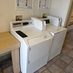 Two washers and two dryers.