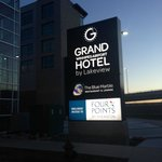 Outside sign lit up at night, The Grand Winnipeg Airport Hotel  |  1979 Wellington Avenue, Winni