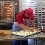 Preparing fresh baked cherry strudel