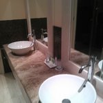 Two sinks, shower and bath tube
