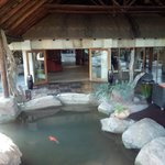 Guest relaxation area at Koi fish pond - reception in backgruond