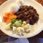 Beautiful braised beef, fresh vegetables and creamy mash.