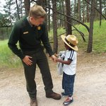 Our ranger giving my son a patch and badge