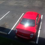 Red roof car in the parking lot of the Red Roof Inn!