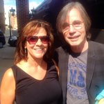 Jackson Browne and my wife in front of the Hampton Inn.