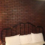 Creepy brick wall behind the bed