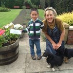 Sarah with Nicholas after they planted a Greengage Plum in the trough.