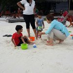 Kids learning castel making on the beach