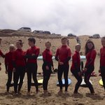 Red rebels at beach briefing