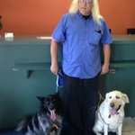 Ron, the very nice manager of Motel 6, gladly poses with my dogs.