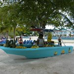 Boat on the beach filled with fresh fruit