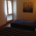 Twin beds and window without curtains