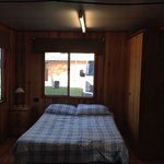 cabin - double bed, bedside table, cupboard. also has curtains for privacy.
