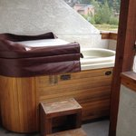 Hot tub in one of the creek-side, ground-floor rooms