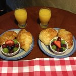 The continental breakfast, which consists of a croissant, a pain de chocolat (pastry with chocol
