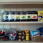 tea, jam, cereal selection in dining room