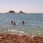 Main beach in Petrovac...small pebbles..aqua shoes good idea to ease the pain:-)