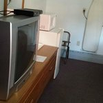 tv, fridge, and microwave in room