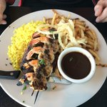 Steak with grilled shrimp, saffron rice and fries