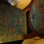 "Stained torn up chair in my ""deluxe king"" room"