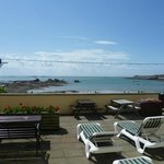 Our sun terrace room with loungers and tables etc over looking the sea.