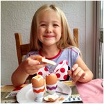 Enjoying her dippy eggs! Thanks Menna & Peter