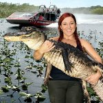 """Gator Boy"" Ashley Lawrence with the Glade Runner flying over a river of grass behind her"