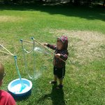 Fun making giant bubbles as part of the park activities set up for kids
