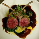 Dijon and parsley crusted lamb rack with mint jus, seasonal vegetables,  roasted potatos