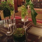 Submerged orchids and green hydrangias in the lobby
