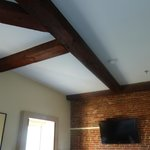 Exposed beam and brick wall in Junior Suite