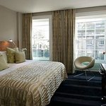 Our room was this type, with large windows, excellent bed, & good storage