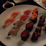 Salmon, Tuna, Eel, Mackerel, Ikura, and Spicy Crab Sushi.