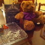 Beautiful chocolate cake and Harold the Windsor Bear