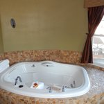 Beautiful jacuzzi tub in #417 with spot to put wine!