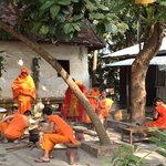 Young Monks Relax at Wat Xieng Moune - with smart phones