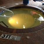 Yellow cloudy hot tub