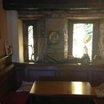 Main bar, lovely stained glass. Great fireplace.