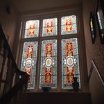 Stained glass window on the stairs. Lovely!