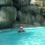 Me under the pool waterfall