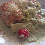 Salmon and pasta in basil cream sauce.