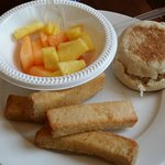 Breakfast with fruit and french toast sticks